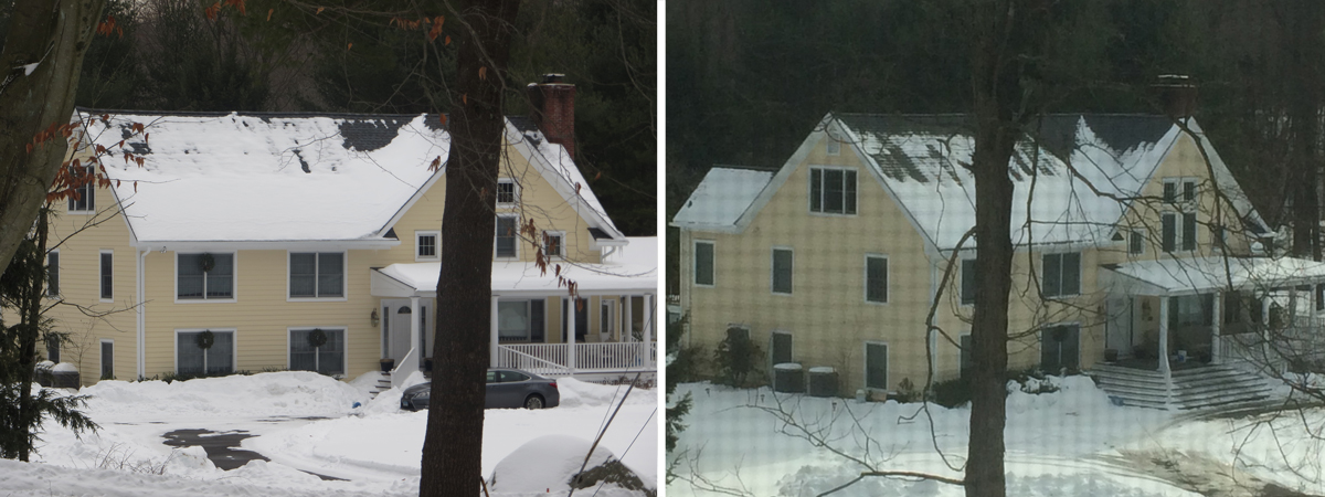 House with snow melting at top of roof